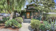 Known as the August House, the Asian-influenced Craftsman was built in 1913. The four-bedroom, two-bath bungalow features original woodwork, hardwood floors, built-ins, and stained glass accents. Last sold in 2001 for $545K, it's now asking $1.275M.