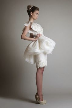 Attention all high fashion brides! Your couture wedding dress dreams are about to come true. We are swooning over Krikor Jabotian's Spring/Summer 2014 bridal collection. Jabotian's newest line is all about texture:flower appliqués, beading, feather accents, sequins, and lace.Each dress is breathtaking, and his designs are as equally beautiful and intricate from the back as read more...