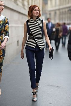 Shop this look for $483:  http://lookastic.com/women/looks/scarf-and-belt-and-sleeveless-top-and-clutch-and-skinny-pants-and-sandals/1464  — White and Black Vertical Striped Scarf  — Black Leather Belt  — Navy Sleeveless Top  — Black Leather Clutch  — Navy Skinny Pants  — Black and White Plaid Sandals