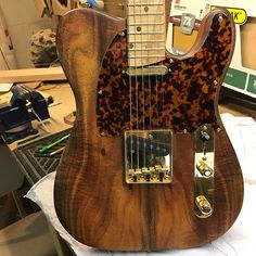 Happy #teletuesday ! Just put a tort #pickguard on @jamezsan 's #koa topped Eve. Whatcha think? #AgapeEve #luthier #custom #handmade #boutique #guitar #electricguitar #fender #gibson #customguitar #handmadeguitars #curves #everydaybeauty #nofilter #wood #woodworking #AgapeGuitars #telecaster #tonewide #woodporn #guitarsdaily #guitarsofinstagram #mcnellypickups