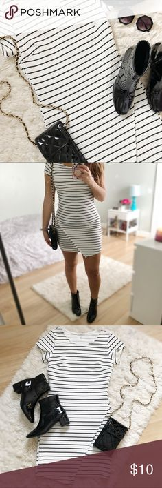 Asymmetrical black & white body con dress This is very cute black and white striped body con dress. With a cute asymmetrical detail on the front. Only worn a few times. Great condition. Stretchy fabric. Charlotte Russe Dresses