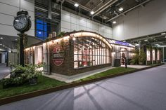 Cersaie 2015 - Fabuloft - Stand Novoceram - Grande verrière au style industriel du Loft #WeLoftYou #Horloge #briques #style #industriel #carrelage #loft http://www.novoceram.fr/blog/scenographies/fabuloft