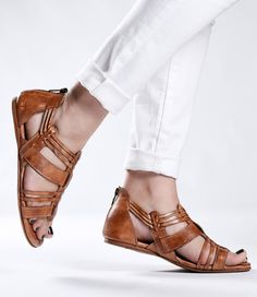 Your search for the must-have tan sandal is over. The CARA is handwoven by skilled artisans over several hours, showcasing its individuality. Perfect for a day out with friends, the CARA will be your best friend for spring.