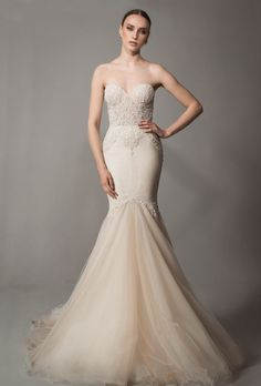 Mermaid gown with nude/blush undertones, stunningly intricate beaded bodice and tulle skirt.