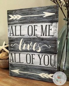 What a gorgeous sign to showcase your love- John Legend style! Makes a great wedding, engagement, or anniversary gift! Our high quality signs are hand crafted, start to finish and are true labors of love. Rustic, vintage planked pallet All of me loves all of you quote board sign. Stained a beautiful dark walnut base with alternating white and gray washed boards, then lovingly distressed and hand-painted with contrasting gray and heirloom white lettering. Since we do use natural wood, grain…