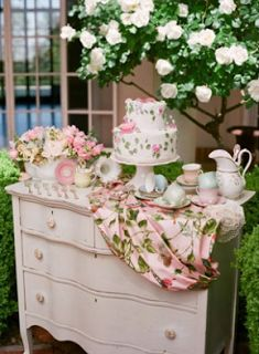 Garden tea party ~ love the vintage dresser and floral fabric