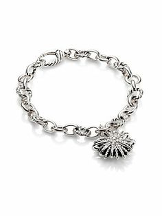 would like to find Swarovski crystal and sterling for a little less than 1500..   David Yurman Diamond and Sterling Silver Starburst Charm Bracelet