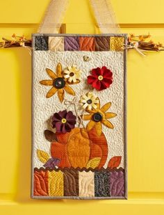 I like the idea of using a mini quilt on a door - Decorating With Quilts | AllPeopleQuilt.com