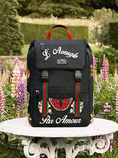 """The embroidered backpack featuring appliqués and the phrase """"L'Aveugle Par Amour"""", from Gucci Cruise2017 by Alessandro Michele."""
