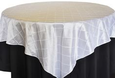 White Pintuck Table Overlay provided by Waterford Event Rentals.