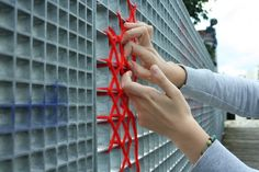 Cross-stitched street art — Artist uses string to leave hearts behind on grates and fences [9 pictures]