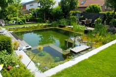 Dive into 25 all-natural swimming pools and water gardens that feature lush…