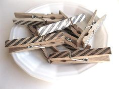 tea-stained clothespins with stamped stripes...just made similar ones for my playroom with aqua striped Washi tape