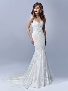 NEW ARRIVAL Introducing 'January' from the 2017 #Enzoani Blue collection. Ultra-romantic and gorgeously feminine. This full-length mermaid gown is instantly breathtaking with intricate Chantilly lace overlay, Guipure lace, and the most delicate eyelash hem lace. Combined with a sparkling spaghetti straps with crystal stones and a stunning beaded illusion V-back with crystal buttons closure, January is the picture of modern romance. Our sample is a UK12 in Ivory…