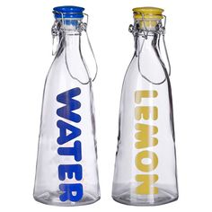 Glass+bottle+with+typographic+detailing+and+a+bail+and+trigger+closure.  +  Product:+Set+of+2+bottlesConstruction+Mat...