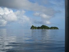 Palau island in tranquil sea.