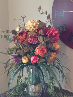 Deep pinks, purples and reds to cream, yellow, and coral, curly willow & eucalyptus.