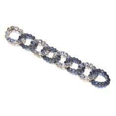 Formerly the Duchess of Windsor's SAPPHIRE BRACELET, CARTIER, CIRCA 1945Designed as a series of oval links set with cushion-shaped sapphires in alternating light and dark shades of blue, length...