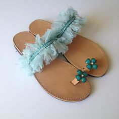Greek leather sandals decorated with light blue lace