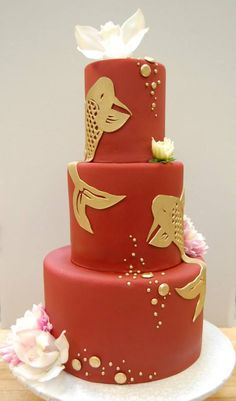 Bold red cake with hand-cut koi fish in gold. Fantastic!