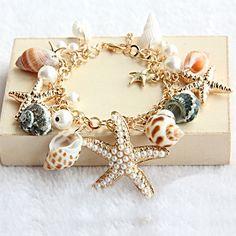 Starfish multi-element shell bracelet from anythingnice on Storenvy