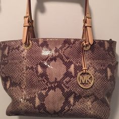 """Snakeskin Authentic MK Handbag This bag is in amazing condition on the outside  no rips or tears. The inside has a lot of pen marks which I tried to capture in the pictures. There is not a dust bag . Two big pockets on the sides and two regular pockets inside with one zip one. The dimensions are 12 """" across and 9 and 1/2 down  straps are 10"""" down. It also zips closed. Amazing MK Michael Kors Bags Shoulder Bags"""