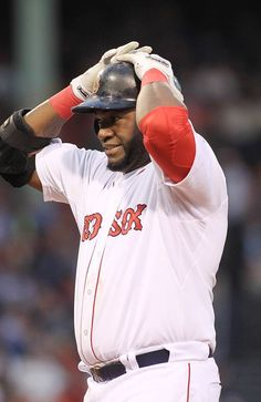 BOSTON, MA - JUNE 19:  David Ortiz #34 of the Boston Red Sox reacts after striking out in a game against theTampa Bay Rays on June 19, 2013 in Boston, Massachusetts. (Photo by Gail Oskin/Getty Images)