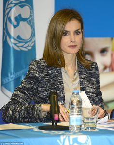 Hard at work: Spain's Queen Letizia was all business as she chaired a UNICEF meeting today...