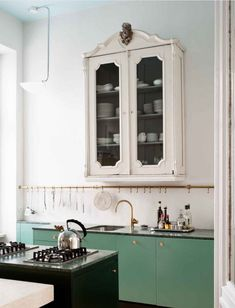 That color green of the cabinet; brass fixtures and use of black: awesome!