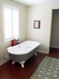 Gray footed bath tub