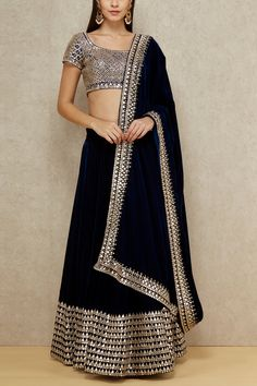 Abhinav Mishra brings a mix of heritage and modernity in a black mirrored choli paired with a lehenga with mirrored border and a dupatta. Style the look with a statement necklace and bracelet. Black Lehenga, Indian Lehenga, Lehenga Choli, Bridal Lehenga, Indian Dresses, Indian Outfits, Mirror Work Lehenga, Indian Wedding Wear, Indian Bridal