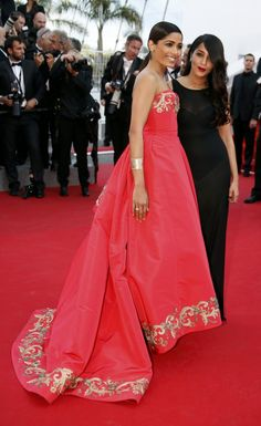 "Indian actress and model Freida Pinto wore Van Cleef & Arpels Perlée cuff in pink gold and Perlée ring in pink gold and diamonds at the 67th Annual Cannes Film Festival Premiere of ""The Homesman""."
