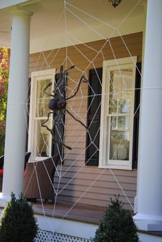 Make your own Halloween spider web decoration for your home! I have done this before using baby yarn and the great thing is if you pick the right yarn you can make it glow with a black light!