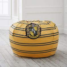 With each beanbag boasting the crests and colors of the four Hogwarts houses, you can proudly show off your school pride with the coziest seat. This Harry Potter beanbag is the perfect spot to keep in your Hogwarts… Hufflepuff Bedroom, Hufflepuff Pride, Yellow Bean Bags, Harry Potter Bedroom, Under Stairs Cupboard, Pottery Barn Teen, Custom Rugs, Pbteen, Slipcovers For Chairs