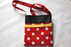Minnie/Mickey inspired Bag.      Great size to hold an autograph book.      Grosgrain ribbon strap can be used to attach those fun collectible pins.