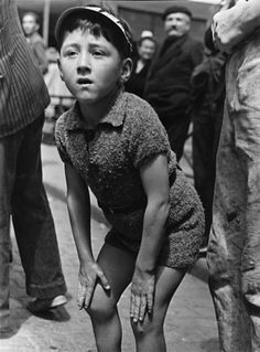 Robert Capa - FRANCE. Brittany. Pleyben. July, 1939. Boy watching the Tour de France.