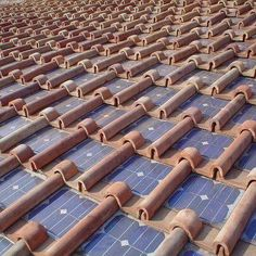 Terra-cotta roof with integrated solar panels.