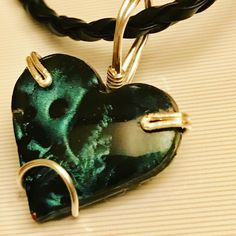 Handmade polymer clay heart coated in resin, pendant wrapped in wire #polymerclay #resin #pendant #heart #wirewrap