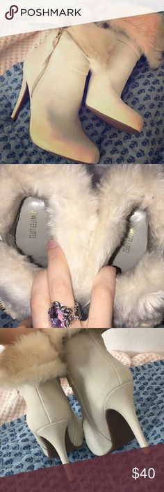 Jennifer Lopez white fur boots Only worn once- some weird wear on the right shoe - these have just been sitting in my closet — pretty zipper detailing Jennifer Lopez Shoes Heels