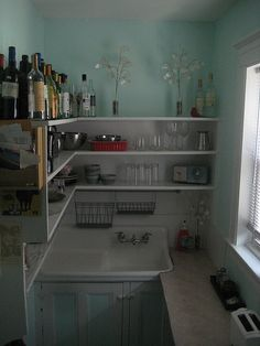 """Tiny kitchen, lots of shelf space, awesome sink.  Something really tiny like this would be perfect for a MIL suite (and by MIL suite, I mean glorified bedroom for my kids when they """"go"""" to college in 10 years)."""