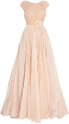 Pastel peach gown. Cap Sleeve fitted bodice is covered with tiny ruffles and petite flowers of what appears to be a raw-edged organza and sparkling beads. Full floating gathered chiffon skirt. Matching corsage-style broach at waist. By Elie Saab. On Lyst