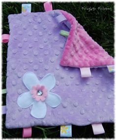 Flora, Pink and Lilac Personalized Minkie Taggie Blanket. $15.00, via Etsy.