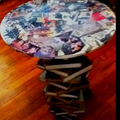 Use old encyclopedias to make an end table. Go through the books first to find pictures that fancy you and cut those out.  Glue the page line to keep the books together. Craft goop the books together in an alternating pattern. Glue the cut out pages to an old table top and then mod podge over the paper the keep it protected from spills. Craft goop the table top to the books and you're done!!