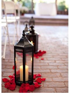 Easy sophisticated aisle decor. You can buy inexpensive lanterns at IKEA and other discount stores. Add rose petals and voila!
