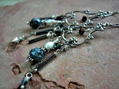 Delicately gothic, these chandelier earrings feature Maiden/Mother/Crone crystals and sterling silver.