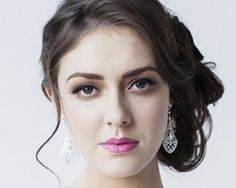 We think these glamourous and eye-catching crystal drop earrings truly ooze sophistication. Handcrafted with attention to detail this stylish pair are set with dozens of sparkling Swarovski crystals.
