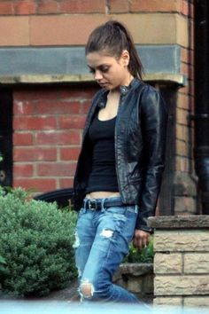 Mila Kunis in a leather jacket, torn jeans, and basic tank. Less is more, simple outfit.