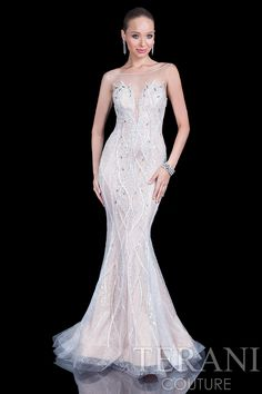 Tulle pageant gown with nude illusion straps. Delicate flowing bead work over a lace and nude lining finish this classy gown.