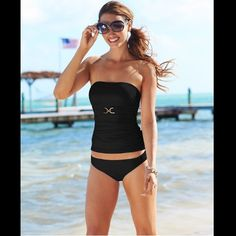 Michael Kors Tankini Swimsuit set in black brand new with tags Michael Kors tankini seim set in black. Beautiful classy top is bandeau style with metal accent under bust, front ruching on both sides. Has underwire but no padding. Can be worn as a bandeau but has straps to add on. The bottom is classic bikini good coverage high rise. Michael Kors Swim Bikinis