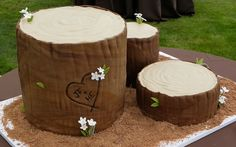 Possibly the Ultimate Rustic Log Wedding Cake, this twist on the traditional all-white wedding cake features a cut-log type design with the couple's name carved
